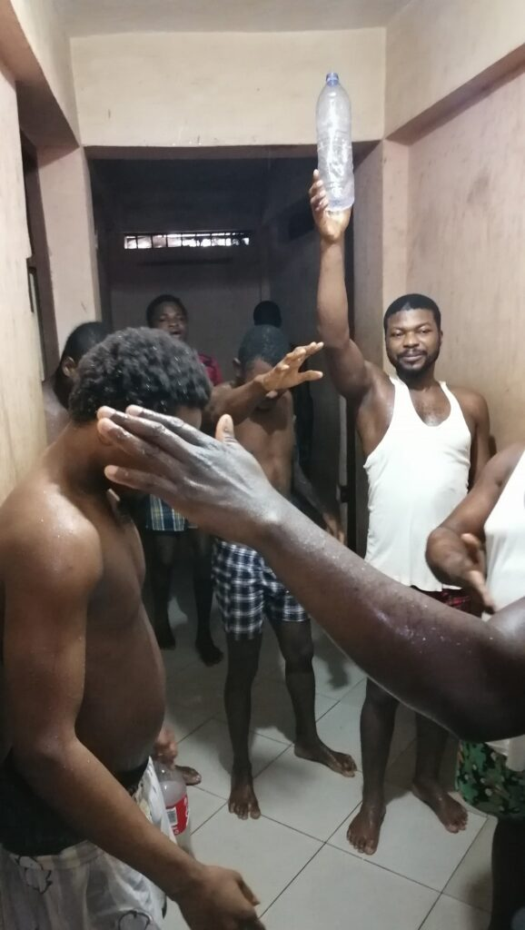 A police officer, Mr. Thomas Adongo organised a mini birthday party for himself, celebrates it was inmates in the Adenta Police Station cells.