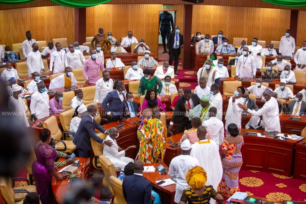 Pictures of MP for Ablekuma West, Ursula Owusu-Ekuful on the floor at the dissolution of the 7th parliament and the inauguration of the 8th Parliament of Ghana's 4th Republic as NDC and NPP MPs fight over majority side of parliament.